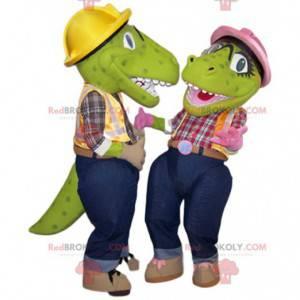 Twee groene dinosaurusmascottes in klusjesmanoutfit -