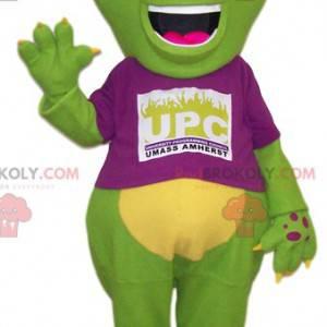 Grande mascote lagarto verde com uma camisa fúcsia -