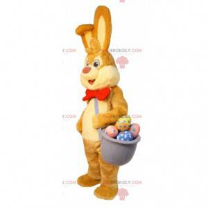 Easter bunny mascot with a basket of chocolate eggs -