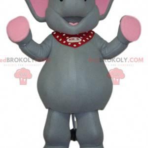 Mascota elefante gris y rosa muy feliz - Redbrokoly.com