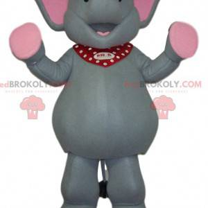 Mascote elefante cinza e rosa muito feliz - Redbrokoly.com