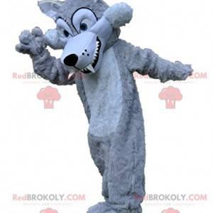 Zilvergrijze wolf mascotte met zijn grote tanden -