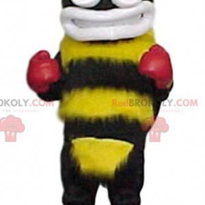 Mascota abejorro amarillo y negro con guantes de boxeo -