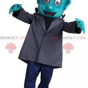 Turkusowa maskotka Frankensteina w szarym płaszczu -