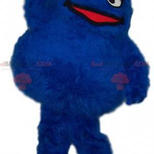 Rundes und haariges blaues Monstermaskottchen - Redbrokoly.com