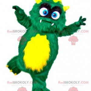 Grünes und gelbes haariges Monstermaskottchen - Redbrokoly.com