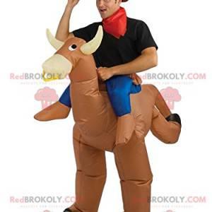Beige Rodeo Kuh Maskottchen mit seinem Reiter - Redbrokoly.com