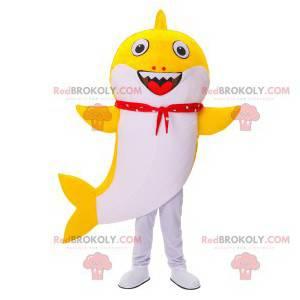 Mascotte squalo giallo e bianco con una bandana rossa -