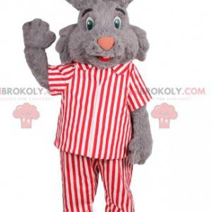gray rabbit mascot with red and white striped pajamas -