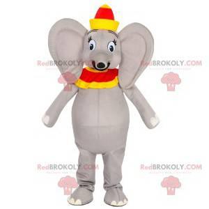 Mascota elefante gris con un sombrero rojo y amarillo -