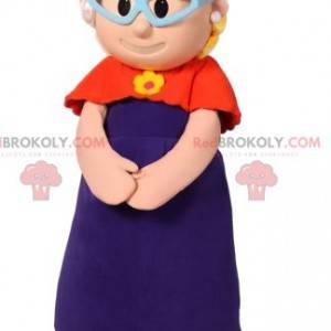 Kleine meisjesmascotte met een rood vest en een fuchsia hoed -