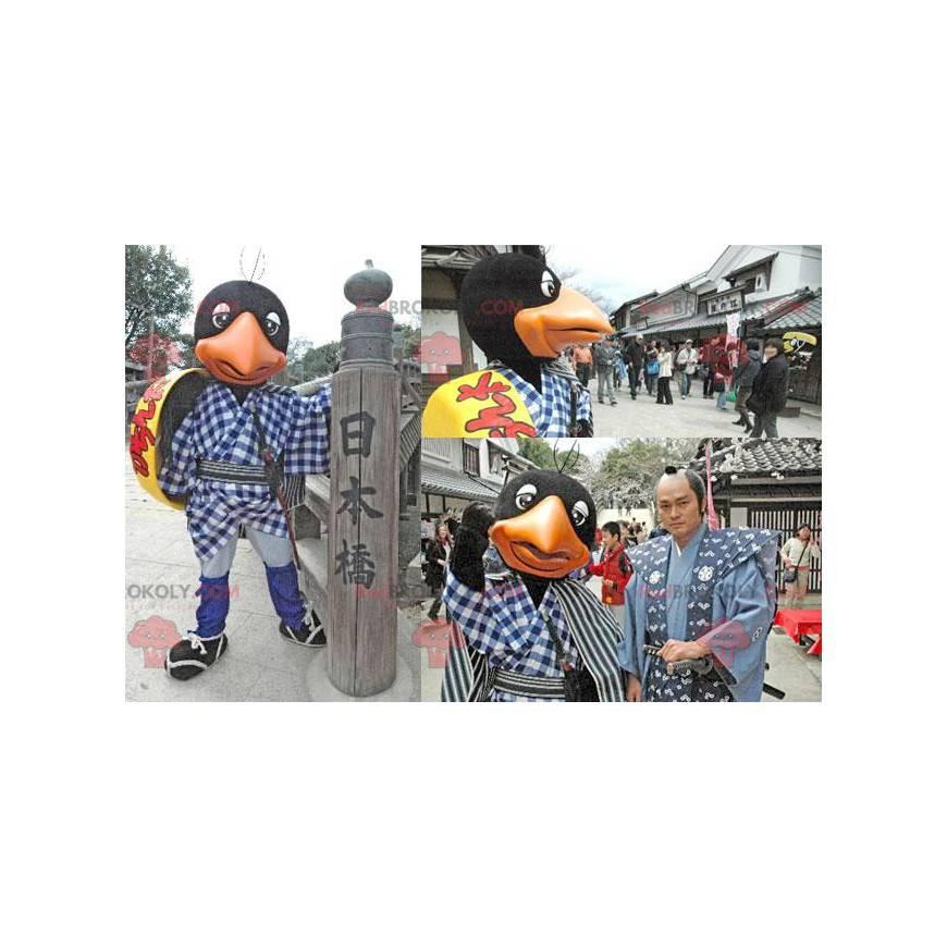 Černý a oranžový pták maskot se žlutým štítem - Redbrokoly.com