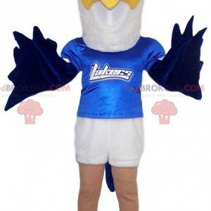 White and blue golden eagle mascot with his blue jersey -
