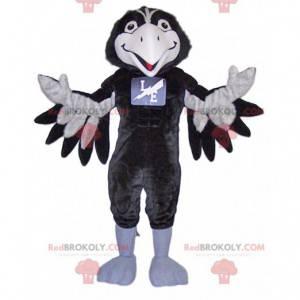 Velmi usměvavý černobílý maskot vrány - Redbrokoly.com