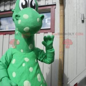 Mascote dragão dinossauro verde com pontos brancos -