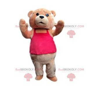 Braunbärenmaskottchen mit einem pinkfarbenen T-Shirt -