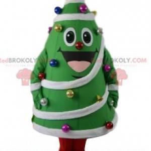 Tannenmaskottchen mit seiner Dekoration. Weihnachtsbaumkostüm -