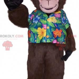 Affenmaskottchen mit einem tropischen Hemd. Affenkostüm -