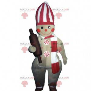 Gingerbread man mascot with a rolling pin - Redbrokoly.com