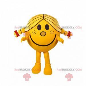 Menina mascote redonda e amarela com lindas colchas -
