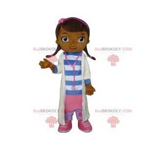 De kleine meisjesmascotte kleedde zich als arts. -