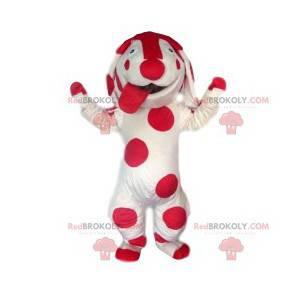 White dog mascot with fuchsia polka dots. Dog costume. -