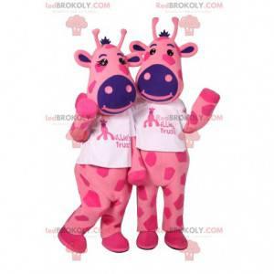 Maskottchen von zwei rosa Giraffen mit lila Flecken -