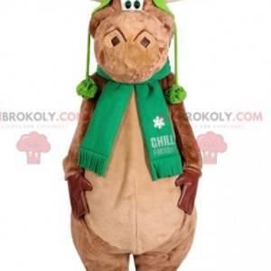 Mascotte della renna beige con un berretto verde. Costume da