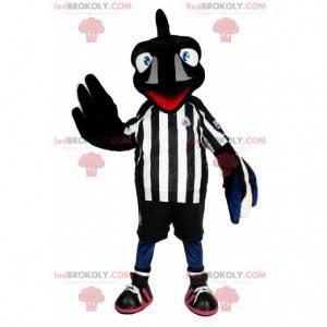 Schwarzes Vogel Maskottchen im Fußballoutfit. Schwarzes
