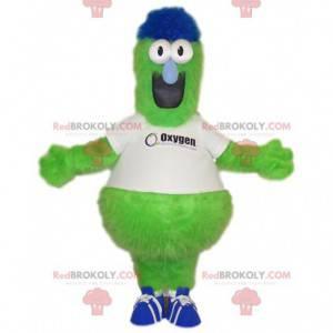 Divertida mascota monstruo verde neón con una camiseta blanca -
