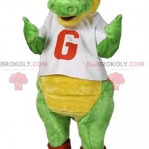 Mascote do dinossauro verde com uma tampa vermelha. -