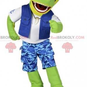 Zelený krokodýlí maskot v modré surfové oblečení -