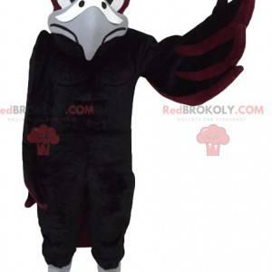 Schwarzes und braunes Adlermaskottchen. Adler Kostüm -