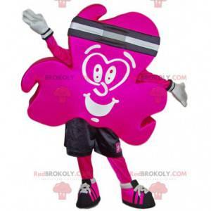 Mascota de trébol fucsia en ropa deportiva - Redbrokoly.com