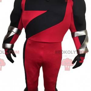 Mascota de superhéroe enmascarado en rojo y negro -