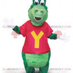 Grünes Krokodilmaskottchen mit einer Kappe und einem T-Shirt -