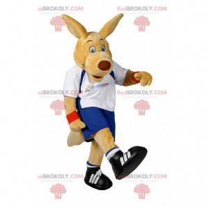 Béžový psí maskot ve sportovním oblečení. Kostým pro psa -
