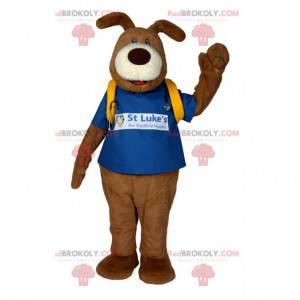 Mascota del perro marrón con una camiseta azul y un