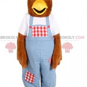 Mascota de pollo con un mono azul. Disfraz de gallina -
