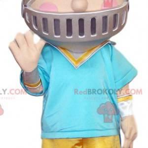 Menino mascote com capacete de cavaleiro. - Redbrokoly.com