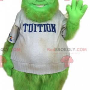 Neonově zelený maskot sněhuláka v studentské oblečení -
