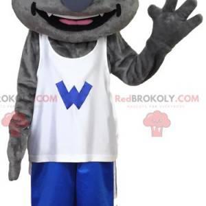 Mascotte lupo grigio in abbigliamento sportivo. Costume da lupo