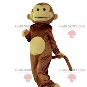 Mascotte della scimmia che ride marrone e gialla. Costume da