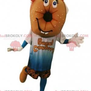 Mascote bagel com uma t-shirt e calções. Fantasia bagel -