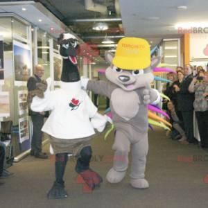 2 mascotes: um avestruz preto e branco e um ouriço colorido -