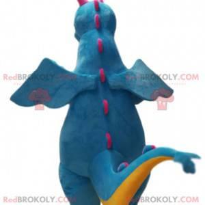 Mascote dragão azul e amarelo muito sorridente. Fantasia de