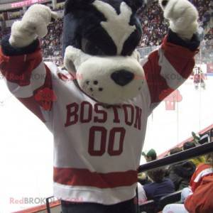 Black and white dog mascot in red and white outfit -