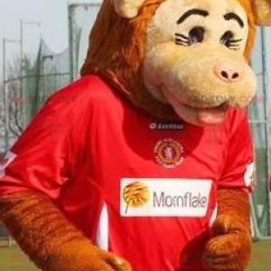 Beżowo-pomarańczowa maskotka małpa w odzieży sportowej -