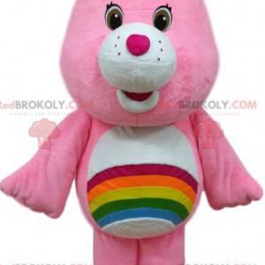 Mascota de oso de cuidado rosa con un arco iris en el estómago.