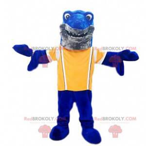 Tubarão mascote azul com uma camisa amarela. Fantasia de